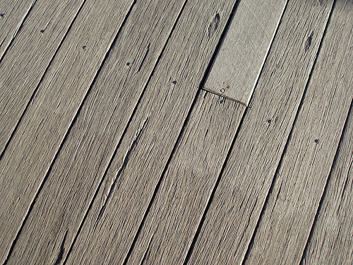 Removing weeds from my wooden Decking